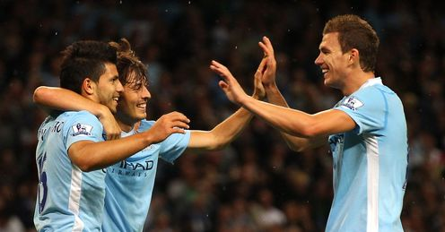 Silva and gold: Aguero and his new mate celebrate with Dzeko