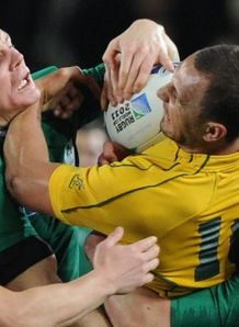 Brian O Driscoll thumping Quade Cooper in Ireland versus Australia at World Cup