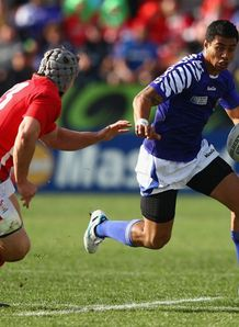 Wales v Samoa - George Pisi attempts to take on Jonathan Davies