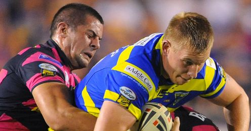 Warrington v Leeds Mike Cooper tackled