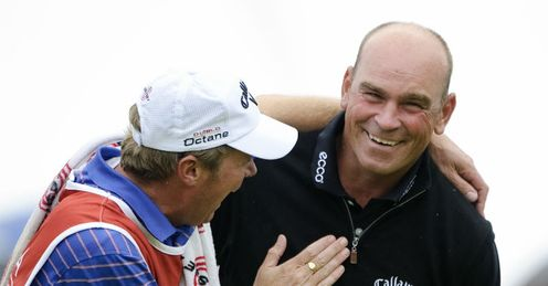 Lording it: Bjorn and his caddie, Gareth Lord, celebrate success