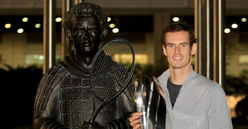A born warrior: Murray stands alongside his terracotta likeness after winning in Shanghai