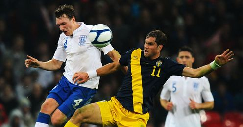 Up to the challenge: Jones keeps a close eye on Sweden's Johan Elmander at Wembley