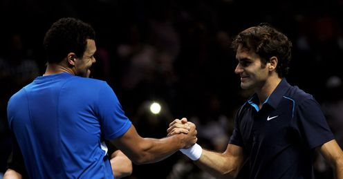 Shake down: Tsonga is all smiles despite his failure to prise the trophy from Federer