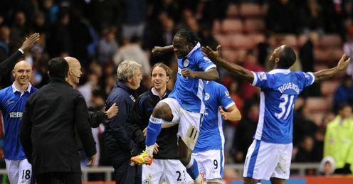 Final blow: Bruce cuts a forlorn figure as Wigan celebrate Franco di Santo's winner