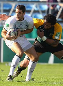 Remi Tales taking on Samu Manoa in Castres v Northampton
