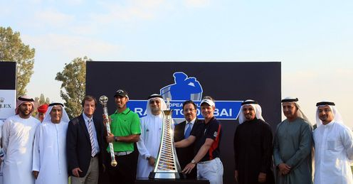 Big winners Alvaro Quiros and Luke Donald pose with officials and sponsors in Dubai.
