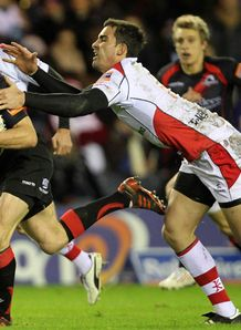 Edinburgh v Ulster Chris Paterson is challenged by Ian Humphreys
