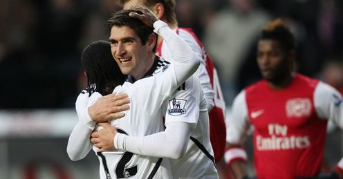 Swans to watch: Graham hugs Dyer during win over Arsenal