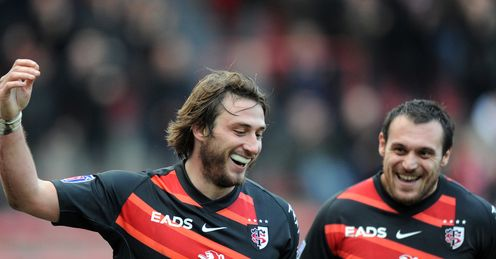 Toulouse s winger Maxime Medard L celebrates next to fly half Lionel Beauxis