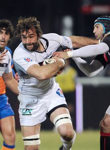 Brive lock Arnaud Mela C is tackled by Lyon