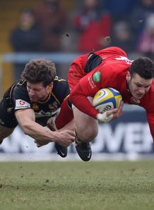 Duncan Taylor of Saracens is tackled by Dominic Waldouck of Wasps