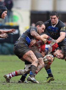 Rory Lawson tackled by Olly Barkley and Francois Louw in Bath v Gloucester