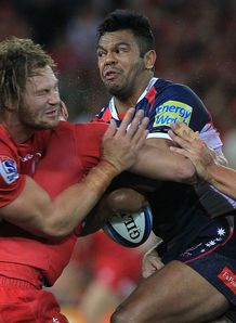 Kurtley Beale taking contact for the Rebels