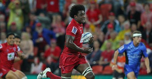 Reds No.8 Radike Samo breaks away to score against the Force