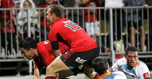Sean Maitland L and Israel Dagg of the Crusaders