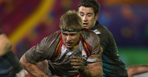 Jevon Groves C of Newport Gwent Dragons chases a loose ball