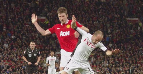 Collision course: Murphy falls under Carrick's challenge but fails to win a penalty