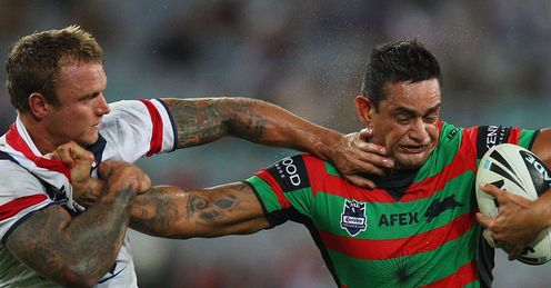 Close run thing: Jake Friend, of the Roosters, tackles the Rabbitohs' John Sutton