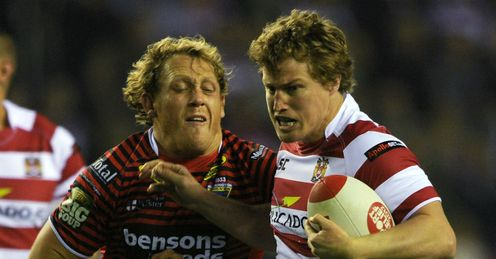 Brett Finch Wigan Warriors running against Warrington Wolves