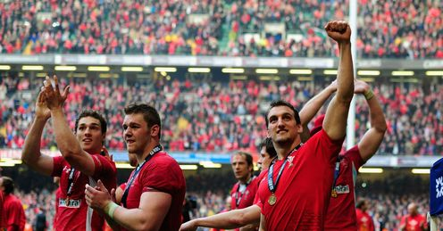 Wales players celebrating RBS Six Nations Grand Slam Cardiff