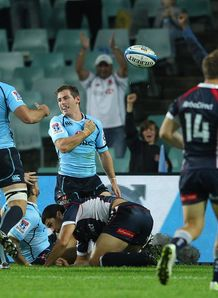 Bernard Foley scoring for Waratahs in Sydney