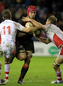 Edinburgh Rugby s Netani Talei right is tackled by Ulster s Craig Gilroy 2nd left and Chris Henry right