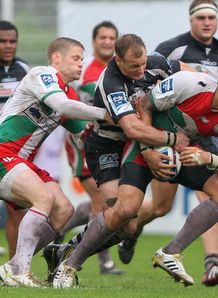 Raphael Lakafia of Biarritz is tackled by Jamie Noon Brive