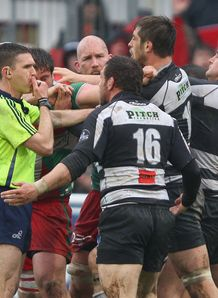 Referee George Clancy attempts to break up a brawl