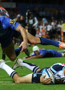 Tom Kingston of the Waratahs dives for a try v Waratahs
