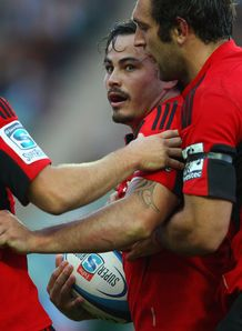 Zac Guildford congratulated after scoring for Crusaders