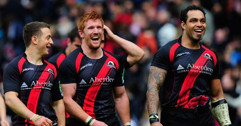 Three-mendous: Greg Laidlaw, Roddy Grant and Netani Talei celebrate victory over Toulouse