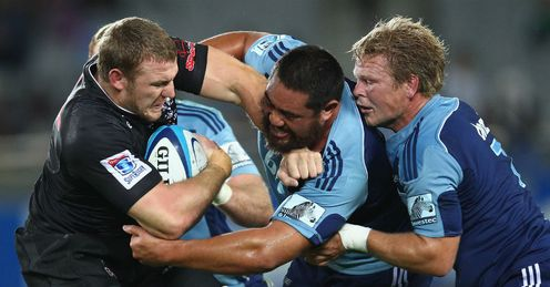 Jean Deysel is tackled by Charlie Faumuina C and Daniel Braid