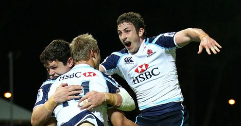 Tom Kingston C of the Waratahs is congratulated by Tom Carter and Brendan McKibbin