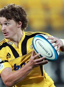 Beauden Barrett of the Hurricanes runs the ball 2012