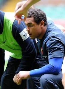 Philippe Saint Andre crouched with Thierry Dusautoir