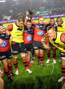 Toulon s players celebrate after winning the Top 14 play off