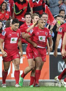 Will Genia congratulated after scoring nice try for Reds