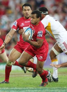 Will Genia of the Reds makes a break to score a try Reds v Chiefs 2012