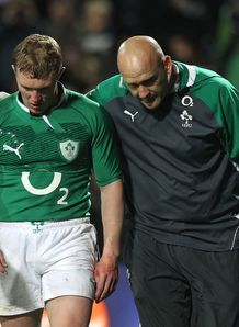 Keith Earls of Ireland L is walked from the field injured
