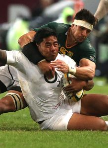 Manu Tuilagi of England is tackled by Pierre Spies South Africa