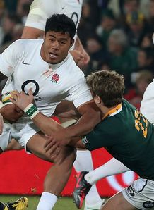 Manu Tuilagi of England is tackled by Wynand Olivier South Africa