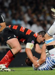 Toulouse s number eight Louis Picamoles C tackled Castres s player Romain Martial