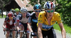 Bradley Wiggins extended his lead at the top of the overall standings on stage six