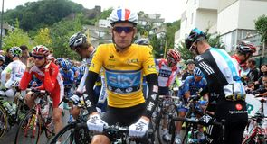 Bradley Wiggins sporting the leader's yellow jersey at the start in Givors