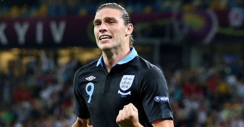 Nine and dandy: Carroll impressed against Sweden but could make way for Rooney