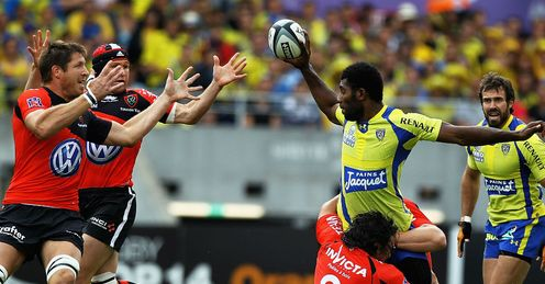 Sebastien Bruno of Toulon tackles Sitenevi Sivivatu of ASM Clermont Auvergne