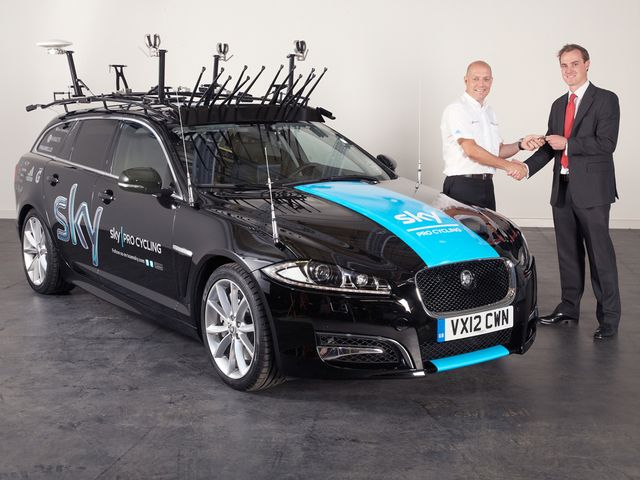Dave Brailsford receives the keys to the new Jaguar XF Sportbrake
