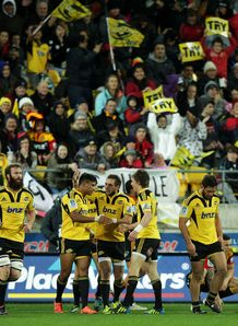 Julian Savea of the Hurricanes is congratulated on his try by teammates