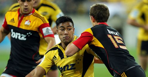 Julian Savea holds off Andrew Hurrell Hurricanes v Chiefs 2012